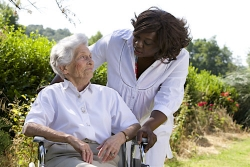 caregiver talking to senior outdoors